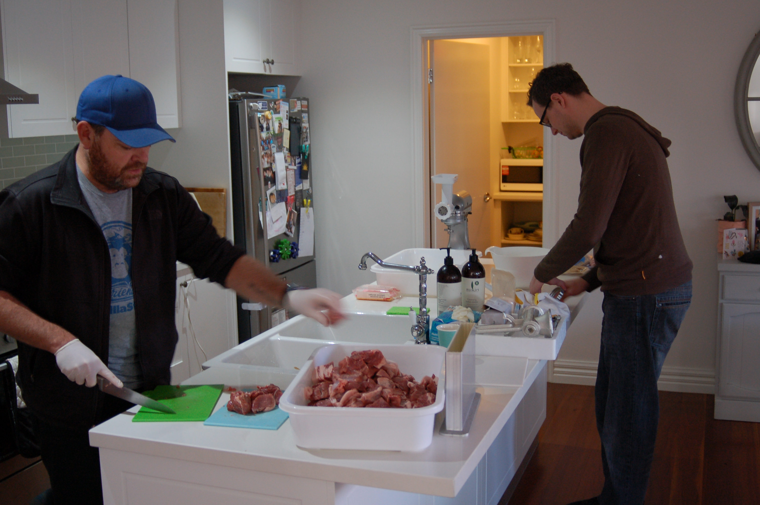 Matt and Dan cutting up the meat ready for mincing